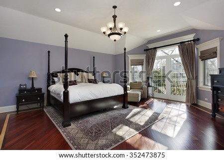 Large master bedroom with doors to balcony - stock photo
