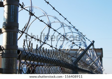 Large metal fence - stock photo
