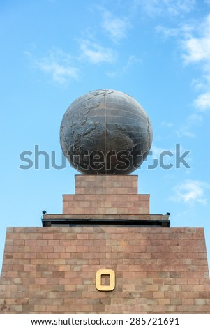 Large metal globe on the top of the monument to the equator in Quito, Ecuador - stock photo