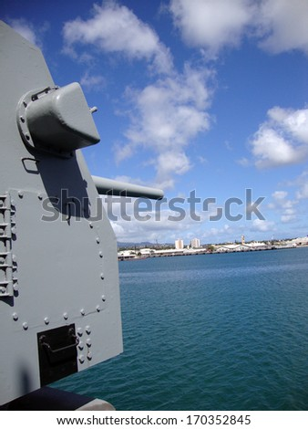 Large Metal Guns on the Historic USS Missouri looking out into Pearl Harbor on Oahu, Hawaii. - stock photo