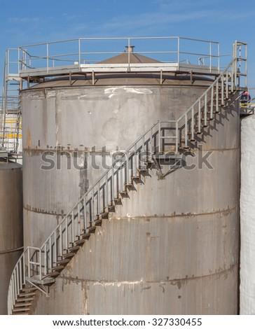 Large metal industrial tanks for petrol and oil storage in refinery industry.