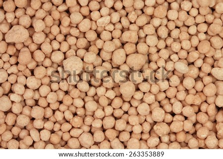 large mineral fertilizers granules abstract background - stock photo