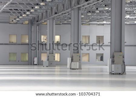Large modern empty storehouse - stock photo