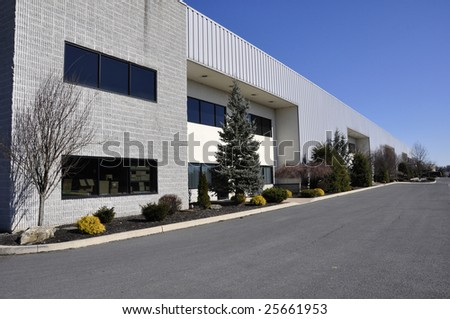 large modern office building in a business park - stock photo