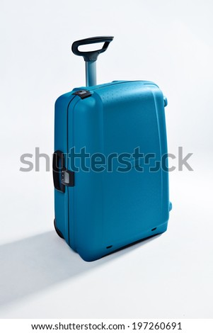Large Modern Polycarbonate Suitcase Isolated on White with Clipping Path - stock photo