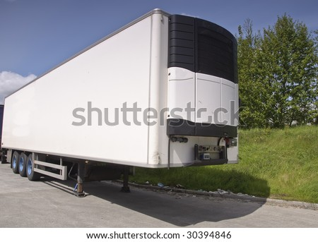 large modern refrigerated truck trailer freight, place advert on white - stock photo