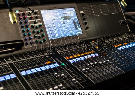Large modern sound show controller panel with screen and presets - side view