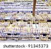 Large modern warehouse with boxes of goods - stock photo