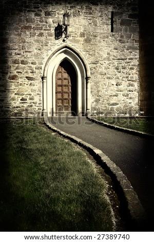 large moody church door in sepia tone - stock photo