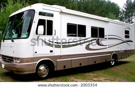 Large motorhome going on vacation - stock photo
