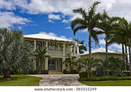 Large New Beach House in Florida with Palm Trees and Landscaping - stock photo