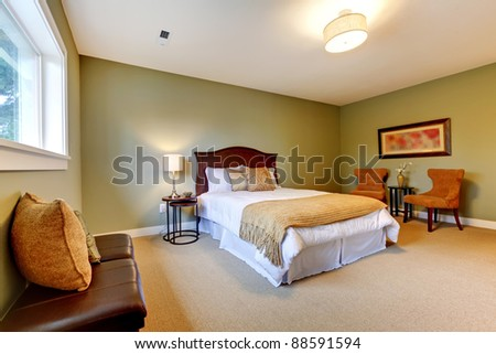 Large new green bedroom well furnished. - stock photo