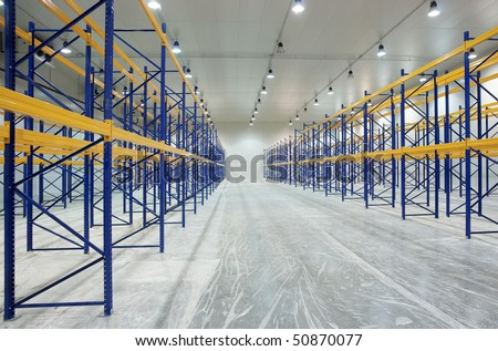 Large newly build warehouse with steel shelves - stock photo