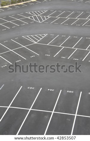 large, numbered empty parking lot corner where rows change direction - stock photo