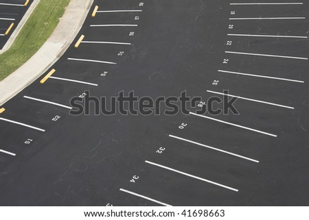 large numbered space parking lot from above - stock photo