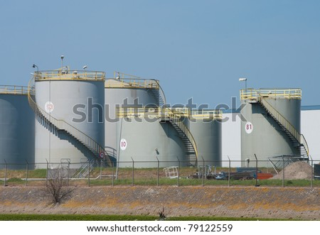 large numbered tanks for petrol and oil in the Rotterdam harbor - stock photo