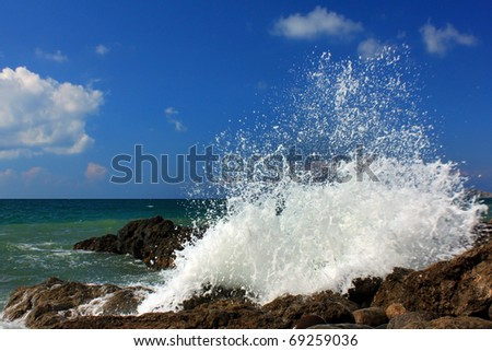 Large ocean waves breaking on a stormy day - stock photo