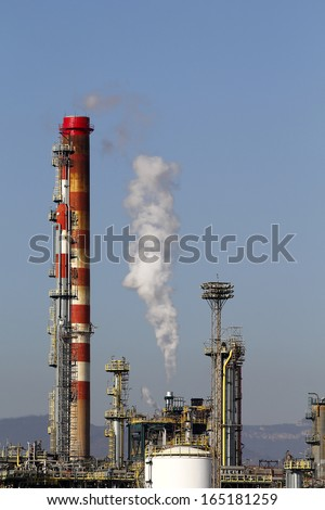 Large oil refinery, with chimneys and towers