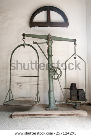Large old antique weighing scale. - stock photo