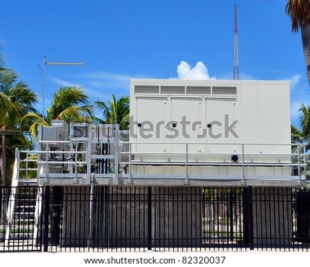 Large Outdoor Industrial Electric Power Generator - stock photo
