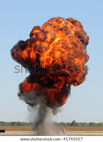 Large outdoors explosion with fire and smoke - stock photo