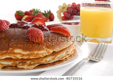 Large pancakes with fresh strawberries