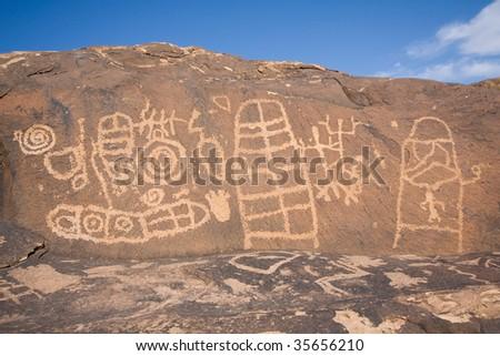 Large panel of petroglyphs carved onto rock surface by prehistoric Native American(s) at Anasazi Canyon, Utah, USA. - stock photo