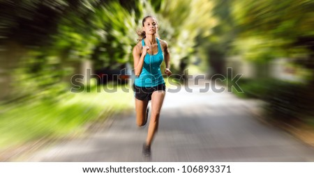 Large panorama image of athlete runner training outdoors. motion blur speed action image showing determination and athletic ability - stock photo