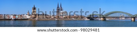Large panorama of Cologne with Great St. Martin Church, Cologne Cathedral, Hohenzollern Bridge and the Rhine river, Germany - stock photo
