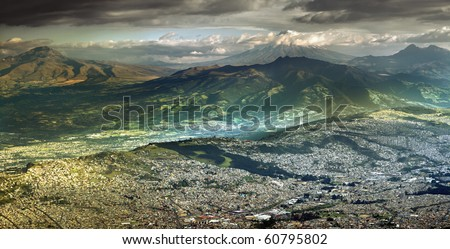 Large panorama of Quito with Cotopaxi volcano in the background. - stock photo