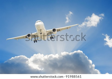 Large passenger airplane flying in the blue sky - stock photo