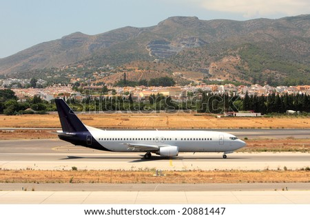 Large Passenger Airplane on the Runway at Malaga Airport in Spain on the Costa del Sol - stock photo