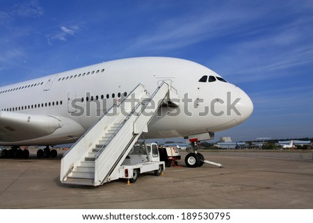 Large passenger jet  with attached ladder - stock photo