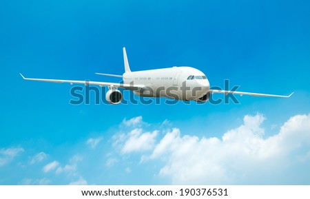 Large passenger plane flying in the blue sky - stock photo