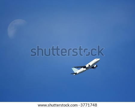 Large passenger plane flying.  Photo taken from ground with plane flying overhead. - stock photo