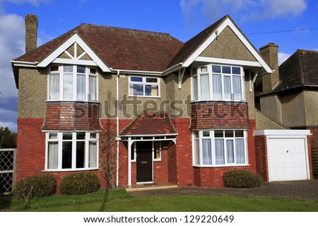 Large pebble dashed detached house with garage in Swindon, UK - stock photo