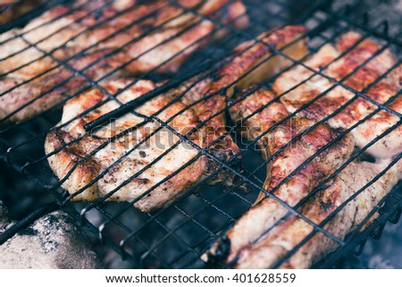 large pieces of pork ribs cooked on the grill
