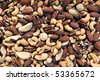Large pile of fancy mixed nuts. - stock photo