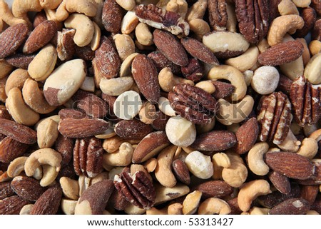 Large pile of healthy premium mixed nuts. - stock photo