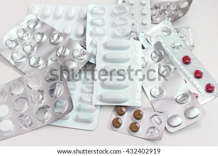 Large pile of medical pills and tablets blisters
