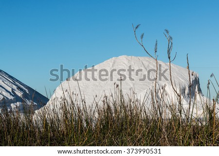 Large pile of natural salt being produced in Chula Vista, California.  - stock photo