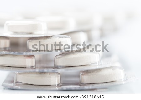Large pile of prescription medicines in blisters - stock photo