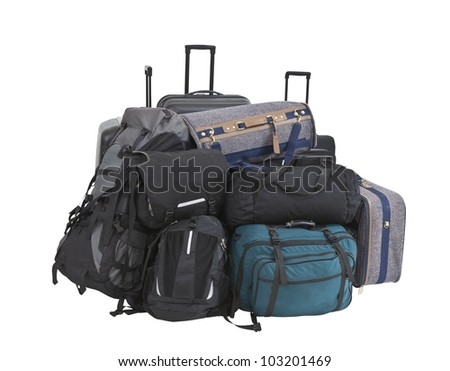 Large pile of suitcases, luggage, bags and backpacks isolated. - stock photo