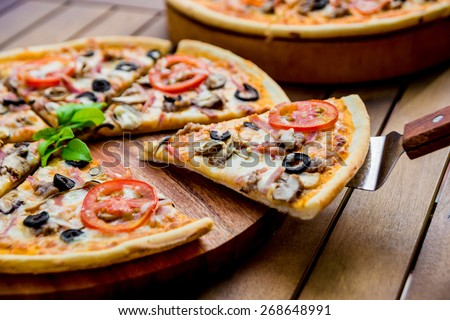 Large pizza on a wooden table. Restaurant