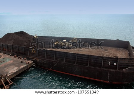 large pontoon boats transporting coal - stock photo