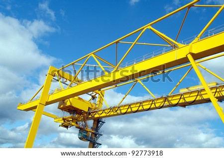 Large portal crane for containers in port - stock photo