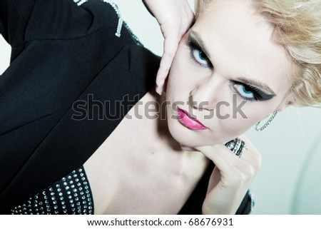 Large portrait of the face and hands with a ring - stock photo