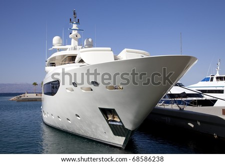 Large private luxury yacht moored in marina - stock photo