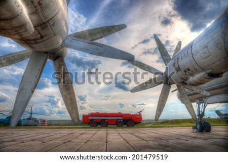large propeller on the airplane wing - stock photo