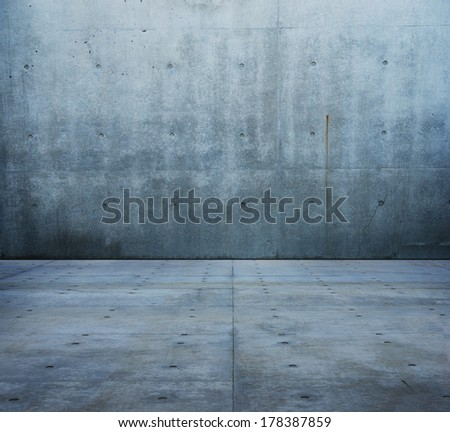 Large raw concrete space. concrete wall and floor.